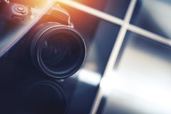 Photography Business Concept. Modern Digital Camera in the Photo Studio. Closeup Photo. 85mm Portrait Lens royalty free stock images