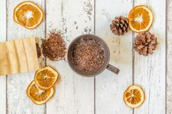 Christmas decoration. Photography Christmas background and dried oranges decoration with cone and hot cup of tea Royalty Free Stock Photo