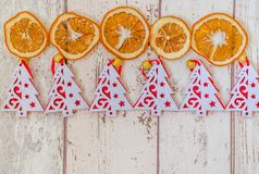 Christmas theme background. Photography Christmas background with many red and white Christmas trees and dry oranges Royalty Free Stock Images