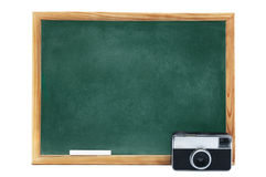 Photography Classes. Blackboard with vintage photographic camera isolated on white background Royalty Free Stock Photo