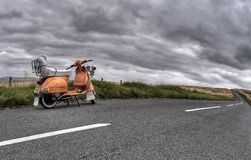 Photography of Classic Motorcycle on Road Royalty Free Stock Photo