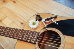 Photography classical guitar on a light brown background Stock Photos