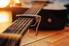 Photography classical guitar on a light brown background Stock Image