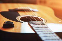 Photography classical guitar on a light brown background Stock Photography
