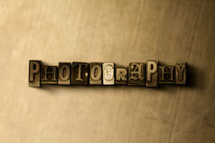 PHOTOGRAPHY - close-up of grungy vintage typeset word on metal backdrop Stock Photography