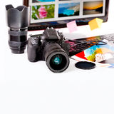 Photography concept. Digital camera, monitor and photos on white background Stock Images