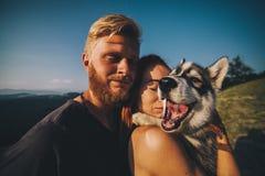 Photography couple and dog stock image
