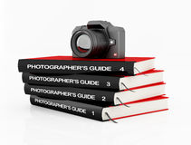 Photography course. Digital camera on a stack of book isolated on white - rendering Royalty Free Stock Images