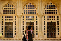 Photography. An enthusiast taking picture of the symmetry of doors that is in front of her royalty free stock photos