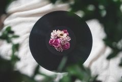 Photography of Flowers On Top of Vinyl Record royalty free stock photo