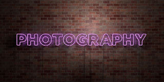 PHOTOGRAPHY - fluorescent Neon tube Sign on brickwork - Front view - 3D rendered royalty free stock picture Royalty Free Stock Images