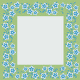 Photography frame with floral motives. Blue flowers on a green frame Royalty Free Stock Photography
