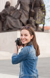 Photography fun. Gorgeous young brunette woman having photography fun Royalty Free Stock Image