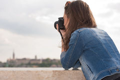 Photography fun. Gorgeous young brunette woman having photography fun Royalty Free Stock Images