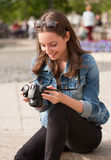 Photography fun. Gorgeous young brunette woman having photography fun Royalty Free Stock Photo