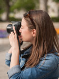 Photography fun. Gorgeous young brunette woman having photography fun Stock Photography