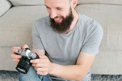 Photography hobby inspiration man camera look. Photography art. hobby creativity and inspiration. photographer leisure and lifestyle. smiling man holding camera Royalty Free Stock Photo