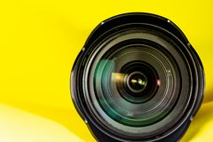 Photography lens aperture on a yellow background. Photo vision concept. Photography wide angle lens aperture on a yellow background. Photo vision concept royalty free stock photography