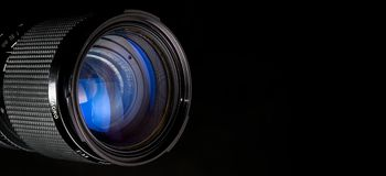 Photography lens over black Stock Photo