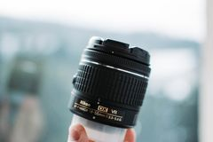 Photography lens with window reflection stock photo