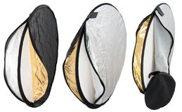 Photography light reflector. Isolated photo of a photography light reflector in silver, white and golden colors, and a bag Stock Photography