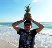 Photography of a Man Holding Pineapple Stock Photo