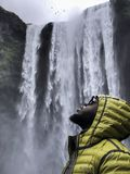Photography of Man Wearing Bubble Hoodie Jacket Near Waterfalls Royalty Free Stock Image