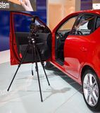 Photography at a motorshow. Photographing an interior of a car at exhibition Stock Photography