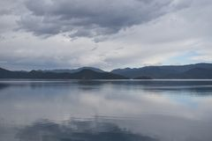 Photography of Mountains Near Body of Water Royalty Free Stock Images