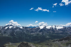 Photography of Mountains Under Blue Cloudy Sky during Daytime Royalty Free Stock Images