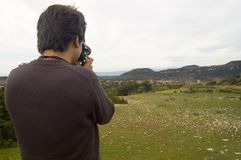 Photography and nature. Photographer taking a photo Royalty Free Stock Photography