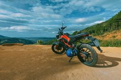 Photography of Orange and Black Sports Motorcycle Near a Cliff Royalty Free Stock Photography