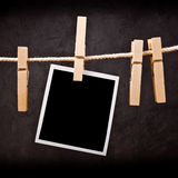 Photography paper with instant photo frame attached to rope with Stock Images
