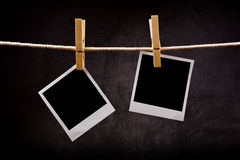 Photography paper with instant photo frames attached to rope wit Royalty Free Stock Image