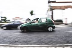 Photography of a Person Driving Green Car Stock Image
