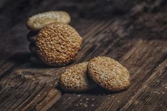 Photography of Pile of Cookies With Sesame Seeds on Table Royalty Free Stock Images