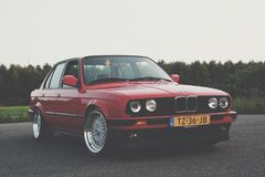 Photography of Red BMW on Asphalt Road Stock Image