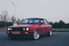 Photography of Red BMW On Asphalt Road Stock Photo