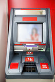 Photography of red cash dispenser. Inside room Stock Image