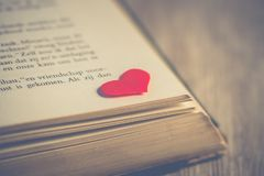 Photography of Red Heart on Book Page Stock Image