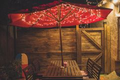 Photography of Red Patio Table With String Lights Stock Photo