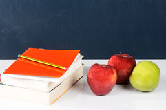 In school and healthy. Photography school supplies along with fresh fruit and tasty Royalty Free Stock Photo