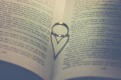 Photography of Silver Ring on Book Stock Photography