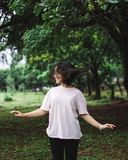 Photography of a Smiling Woman Near Trees stock image