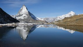 Photography of Snow Mountains Near Lake stock photo