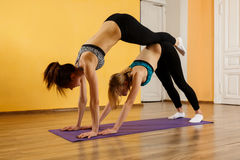 Photography of sportswomen practicing yoga Royalty Free Stock Images