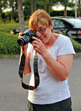 Photography student. Photo of a keen photography student practicing with her new digital camera Royalty Free Stock Images