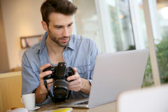 Photography student working on a laptop Royalty Free Stock Photo