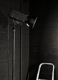 Photography studio light against a black brick wal Stock Photo