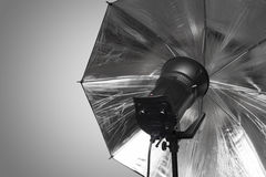 Photography studio strobe flash with silver umbrella Stock Photo
